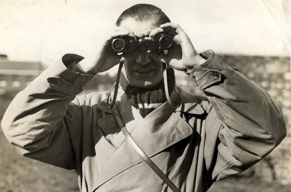 man-with-vintage-binoculars