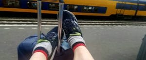 Marty-feet-up-waiting-for-train-to-Amsterdam