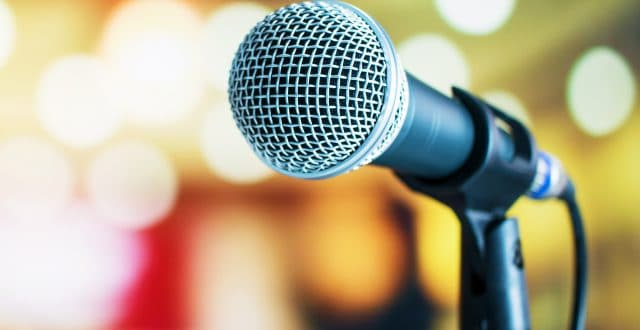 Microphone against a blurred background to introduce, Pubcon Workshops: It's All About The Audience, Marketers