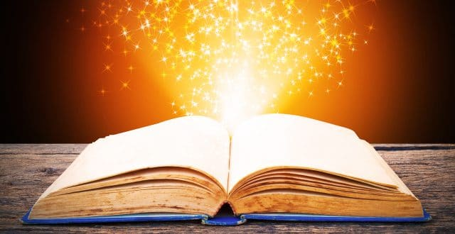 The pages of an opened book glow