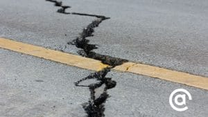 Earthquake crack in roadway representing shifting landscape of paid social ad platforms