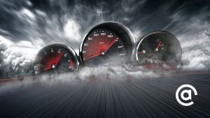 Image of sports car speedometers on crashing waves