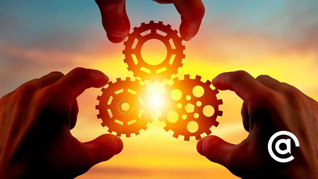 Three gears with the sun in the background to demonstrate connectedness.
