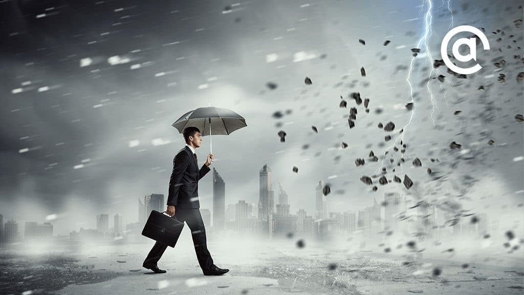 Illustration of a man walking through a storm holding an umbrella