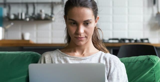 Woman focuses on her laptop.